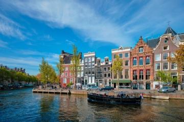 9 Day Amsterdam, Bruges, Paris & London Tour w/ Air